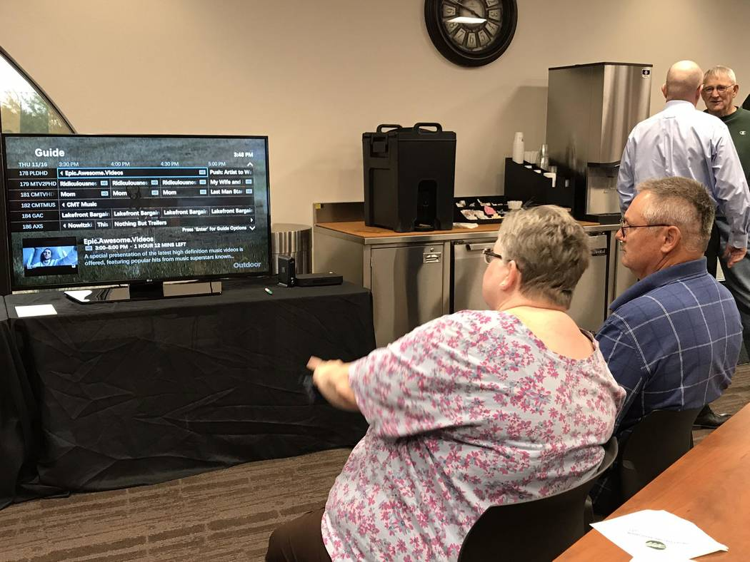 Jeffrey Meehan/Pahrump Valley Times  Attendees of the Valley Communications' Tech Expo on Nov. 16 surf channels on the association's new digital TV service. The expo was held at the Valley Confere ...