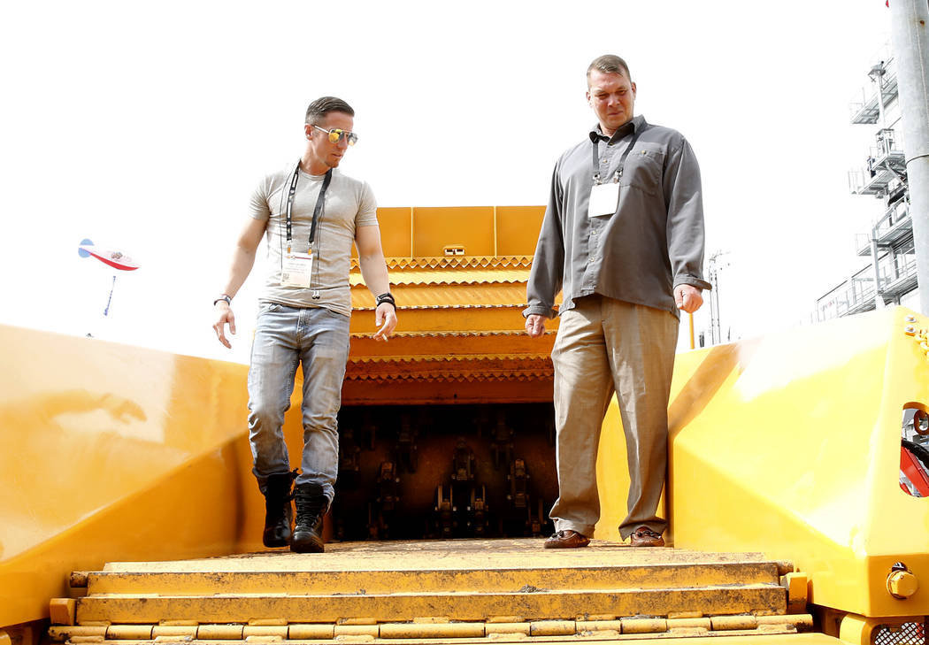 Veterans Erick Georgei, left, and Nick Butler check out the Beast 3680T Horizontal Track Grinder on Friday, March 10, 2017 during the Conexpo at the Las Vegas Convention Center. (Bizuayehu Tesfaye ...