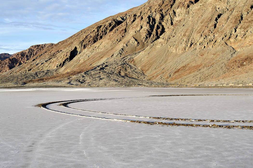 Tire tracks mar the Badwater Basin area in the Death Valley National Park. Officials said tracks left even by a single vehicle in areas with fragile crusts can last for decades. Special to the Pah ...