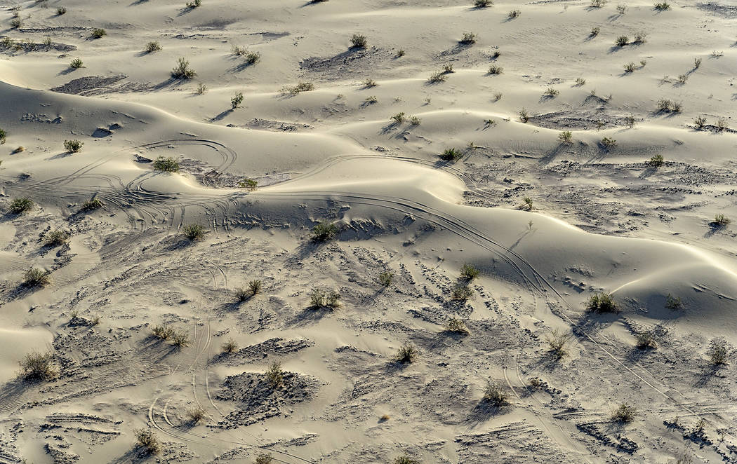 An aerial shot shows an area of the Ibex Dunes that was damaged by off-road driving in Death Valley National Park. After illegal off-road driving has become a problem in several areas of the park, ...