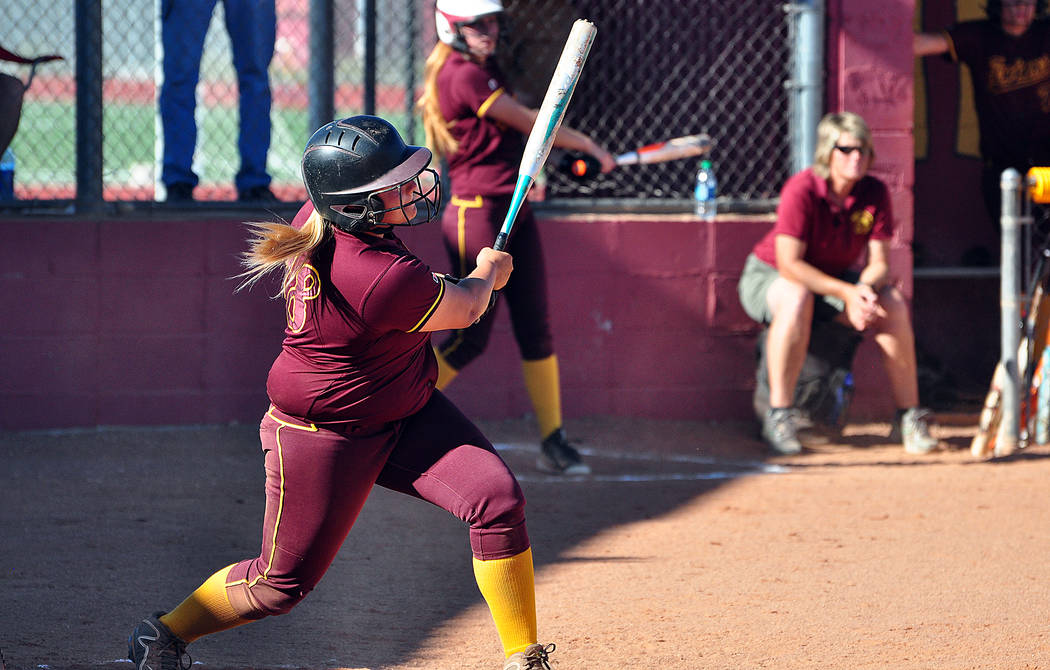 Senior Jordan Egan slugs one out of the park as a sophomore for the Trojans softball team. Fully recovered from last year's shoulder injury, expect Egan to hit a lot more this season. Horace Lan ...