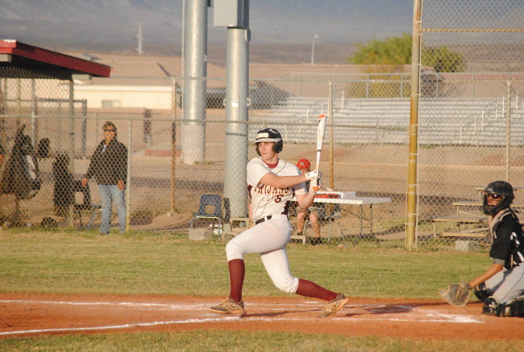 Parker Hart blasts the ball to the outfield last season. He should be one of the best hitters for the Trojans this year. Charlotte Uyeno / Pahrump Valley Times