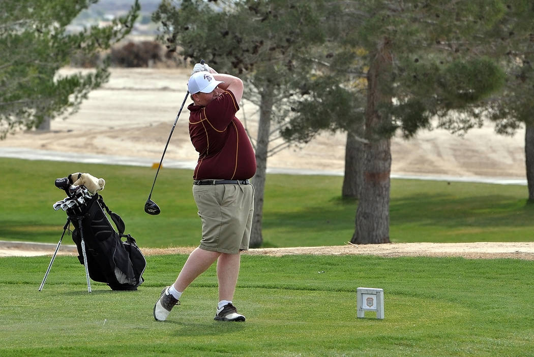 Trojans golfer Mike McDougall is seen teeing off on hole two at Mountain Falls during the Pahrump Valley Invitational on Friday. Horace Langford Jr. / Pahrump Valley Times