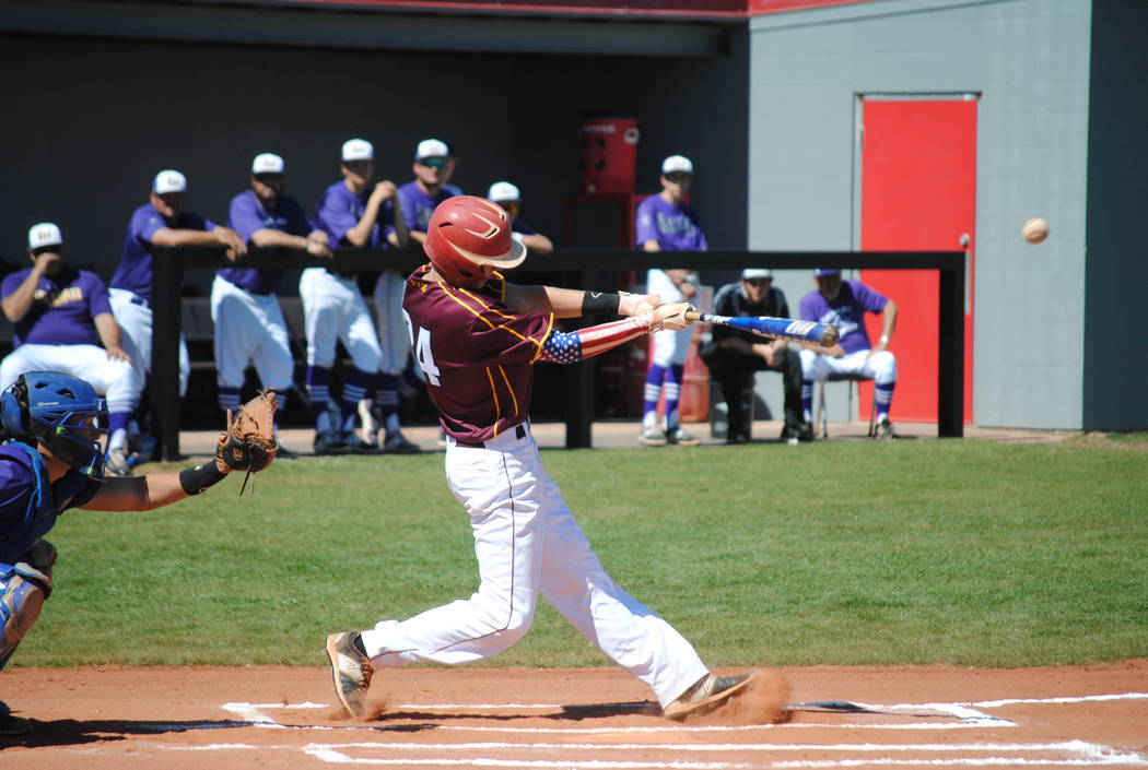 The Trojans' Willie Lucas lets the ball rip in a baseball tournament in Arizona over the weekend. The Trojans went 1-4 but got over their first game jitters and will play this Thursday on the ro ...