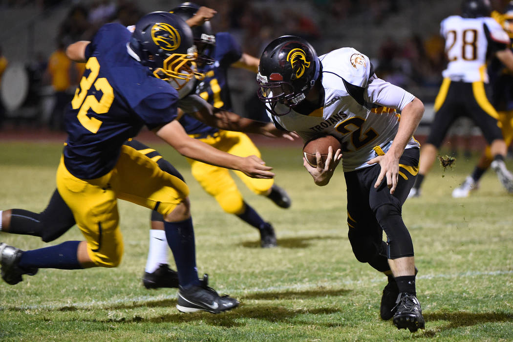 Devlin Dillon is seen running with the ball against Boulder City in 2015. The brothers will play football together next season. Peter Davis / Special to the Pahrump Valley Times