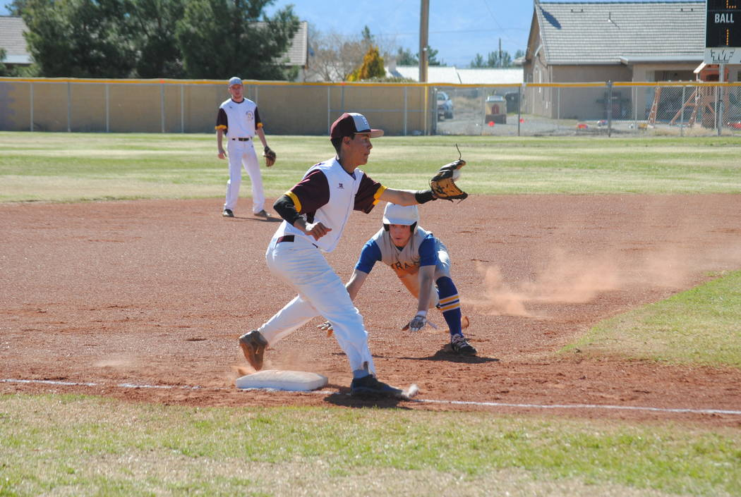 Josh Ferrer attempting the out at third base against the Pirates on Tuesday. Charlotte Uyeno / Pahrump Valley Times