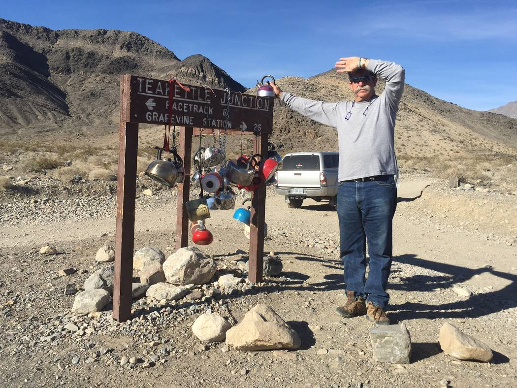 Dee Conton, one of the owners of Death Valley Desert Tours, poses next to a sign en route to the Death Valley National Park Racetrack. Death Valley Desert Tours, that was started by Dee and Barabr ...