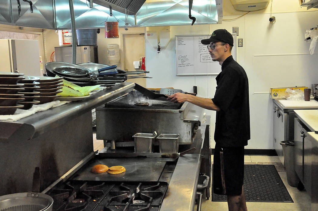 One of the line cooks at $5-$10-$15 prepares a meal for the lunch crowd. Urias says his cooks are trained to make the restaurant's sauces by hand. Horace Langford Jr. / Pahrump Valley Times