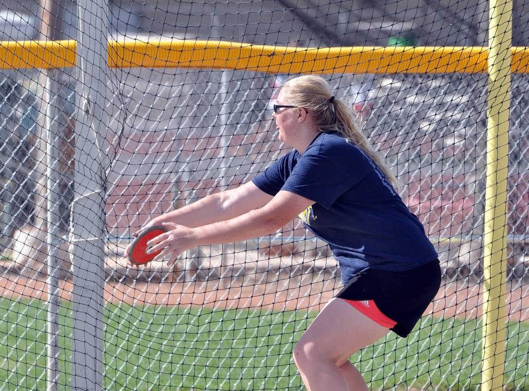 Senior Trojans thrower Caeli Havel seen practicing on Monday. She leads the Trojans girls in throwing the discus and just set a personal best last week in the discus, 140-10. Horace Langford Jr. / ...