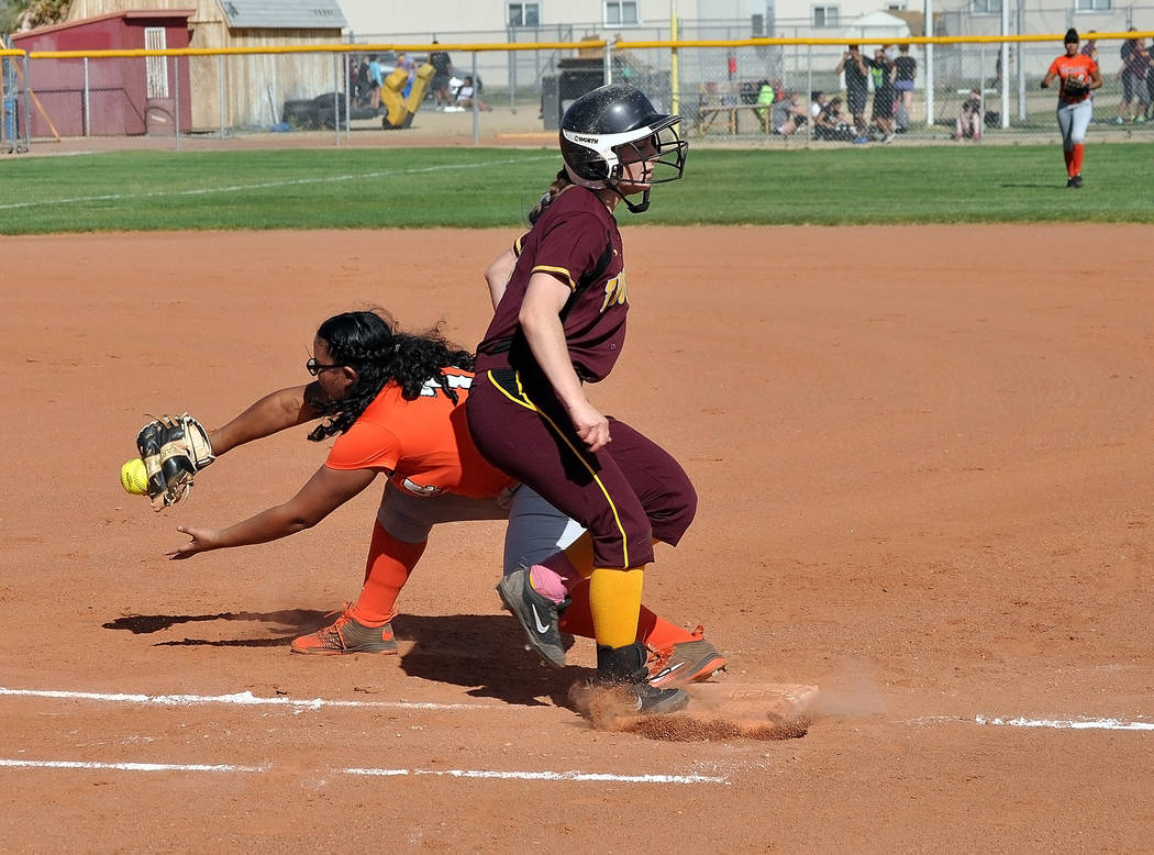 Kathy Niles is safe at first. The Trojans hustled for every base. Trojans coach Eli Armendariz felt his team was far more athletic than the Cowboys. Horace Langford Jr. / Pahrump Valley Times