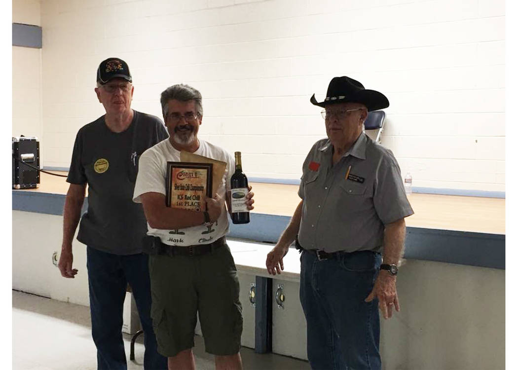 Pahrump resident Mark Haught, center, claimed the top prize following Saturday's ICS Silver State Chili Cook-off at Petrack Park. Haught, flanked by organizer Ron Frazier, left and Pete Caimi, r ...