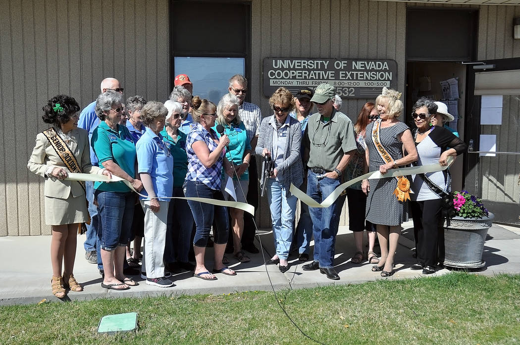 Master Gardeners cut the ribbon Friday in Pahrump with Cherry McCormick shown cutting the ribbon. The Pahrump Chamber of Commerce hosted the ribbon-cutting ceremony for officials from the Universi ...