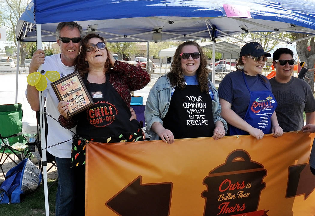 "Horace Langford Jr. / Pahrump Valley Times  At the Silver State Chili cook-off, the crew from ""Our Chili is Better than Theirs,"" poses for a photo."