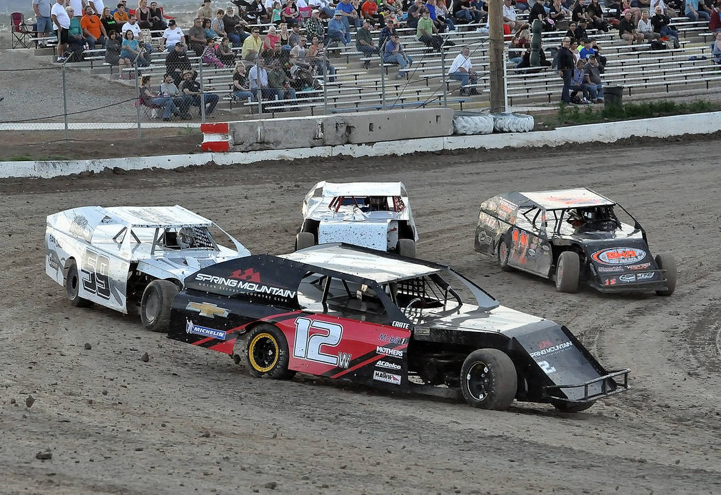 Horace Langford Jr. / Pahrump Valley Times Jim Wulfenstein takes turn one at the Pahrump Valley Speedway during the Stormin' Mormon race in one of the heat races. Wulfenstein survived to advance ...