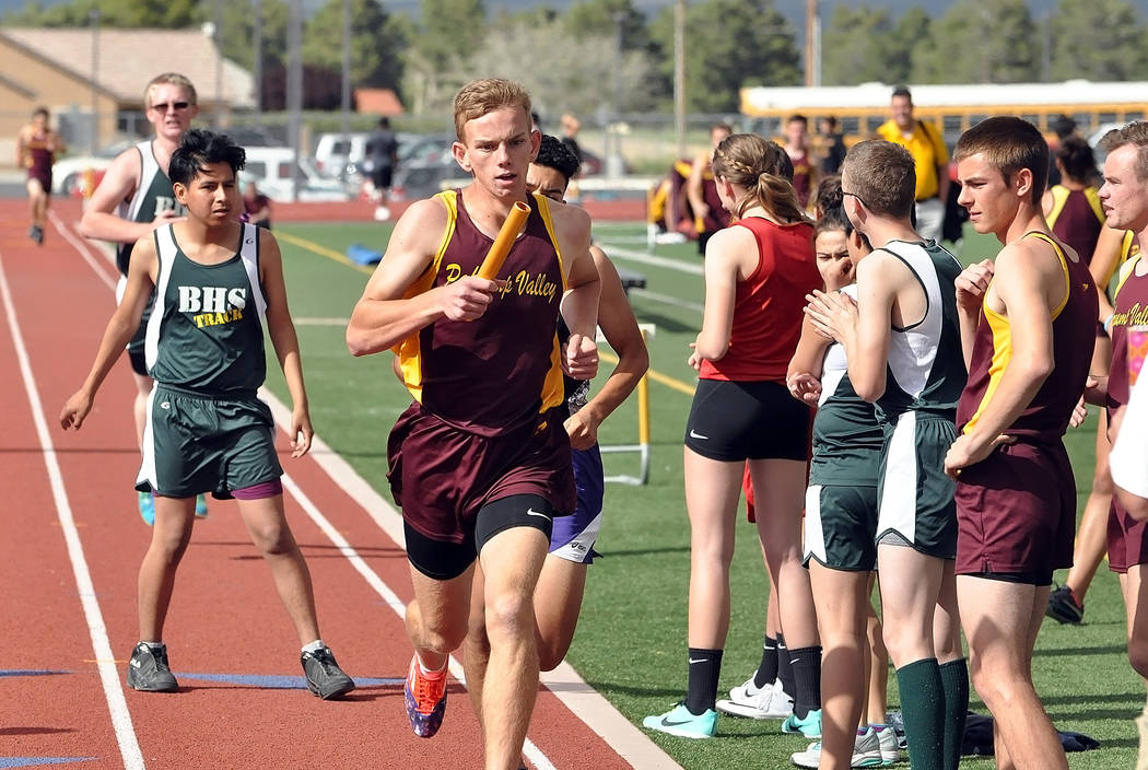 Horace Langford Jr. / Pahrump Valley Times  Layron Sonerholm, with the baton in the 4x800-meter relay at the Pahrump Valley High School track. This relay team, comprised of Bryce Odegard, Nik Clar ...