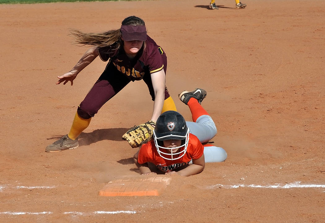 Horace Langford Jr. / Pahrump Valley Times  Trojans first baseman Jill Smith goes for a tag on a Chaparral runner. Trojans coach Eli Armendariz was pleased with the Trojans defense as they made on ...