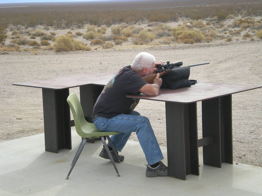 Vern Hee / Pahrump Valley Times Dan Anderson of Beatty takes careful aim with his rifle at the fall VFW shoot. The money raised by the VFW goes back to the community.