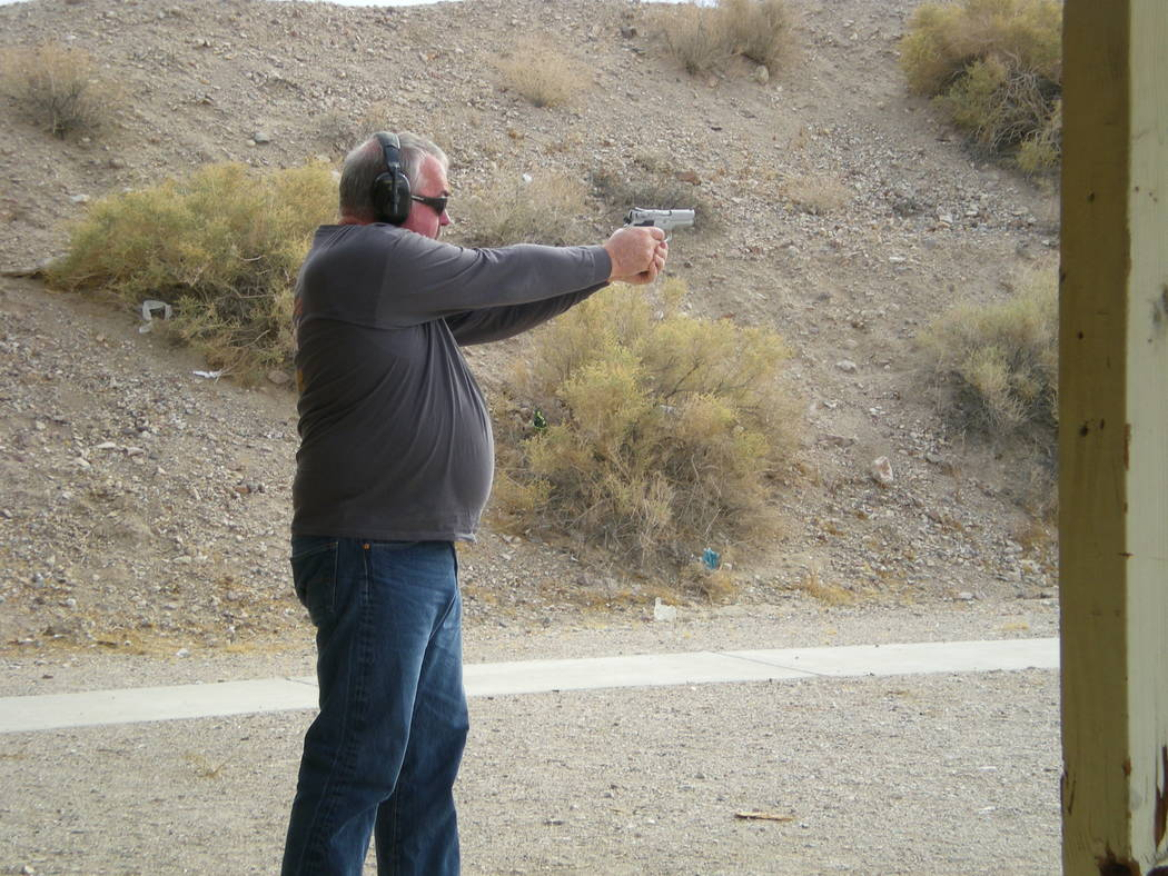 Vern Hee / Pahrump Valley Times An unknown pistol shooter takes aim and shoots at the old range of 50 yards. This spring the range changes to 25 yards. A little bit closer.