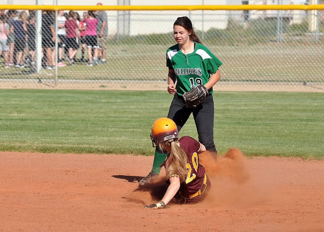 Horace Langford Jr. / Pahrump Valley Times -   Hailey Sanchez slides into second base for the Trojans against Virgin Valley on Tuesday. The Trojans swept the doubleheader.
