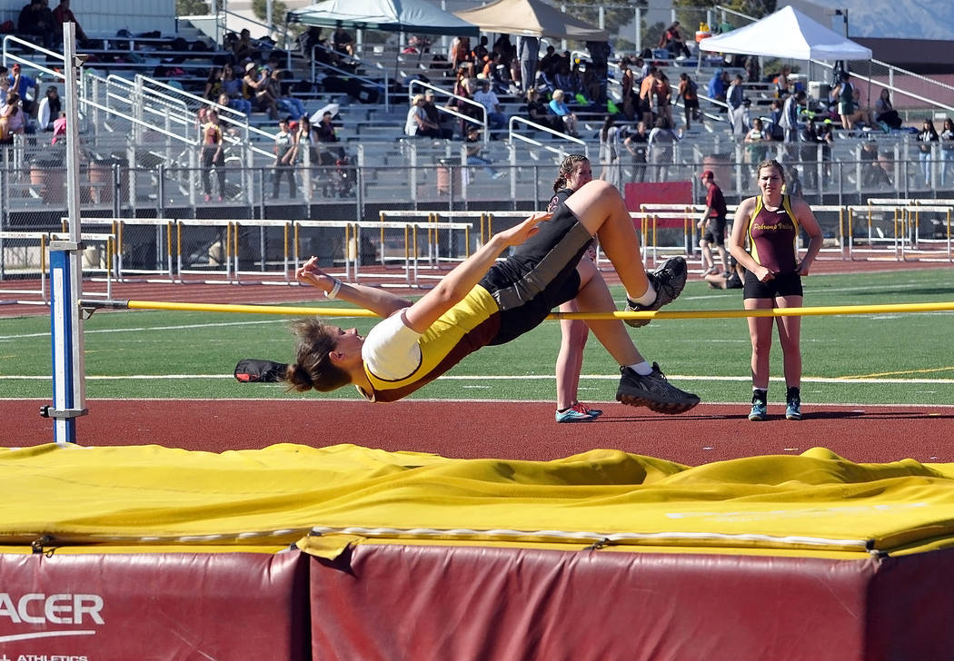 Horace Langford Jr. / Pahrump Valley Times  Sophomore Abbie Schott makes her height for the Trojans girls at Wednesday's five-team track meet. Schott took second place (4 feet, 2 inches). The gi ...