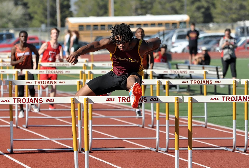 Horace Langford Jr. / Pahrump Valley Times  Top Trojans 110-meter hurdler, Dylan Montgomery, races to a first-place finish on Wednesday in a five-team home meet, where the Trojans boys dominated,  ...