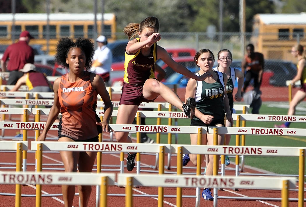 Horace Langford Jr. / Pahrump Valley Times  Freshman hurdler Hannah McElheny clears a hurdle on Wednesday at the second Trojans home meet. McElheny finished fourth (20.6).