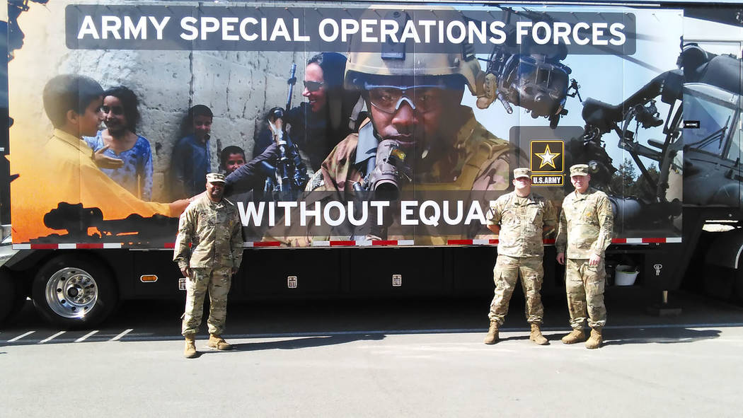 Selwyn Harris/Pahrump Valley Times  Army recruiter Sgt. 1st Class Eric H. Jackson, left, stands before the Army's Special Operations Forces semi-trailer, which provides virtual reality combat si ...