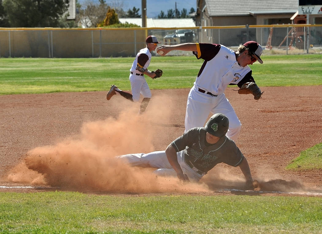 Horace Langford Jr. / Pahrump Valley Times Cyle Havel tries to lay a tag at third base. The Trojans were in the game up until the sixth inning.
