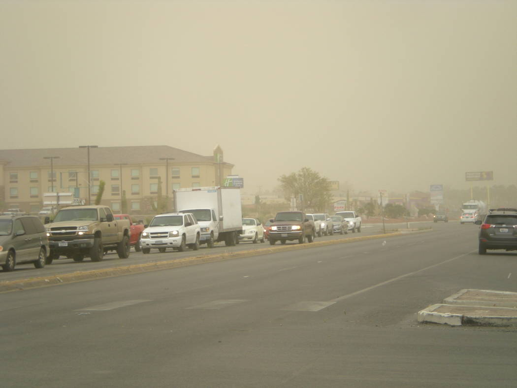 Vern Hee / Pahrump Valley Times The view of Highway 160 at the intersection of Highway 372. The wind was blowing up to 50 miles and hour on Friday and it caused a big dust cloud to engulf the town.