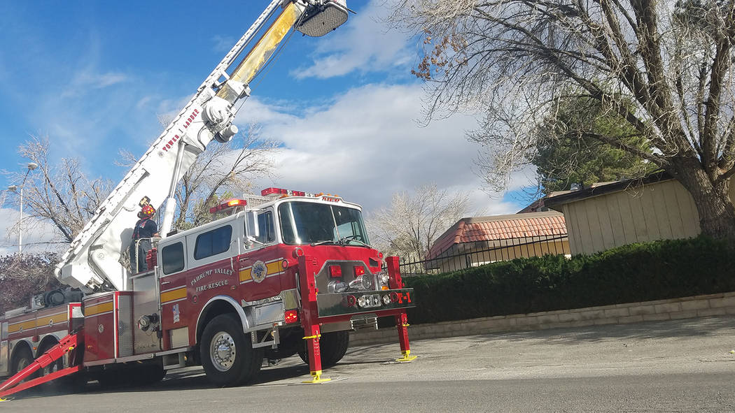 David Jacobs/Pahrump Valley Times Fire ladder truck at work  outside the apartment that burned off Bourbon Street in Pahrump on March 31. No one was injured in the fire that remains under investig ...