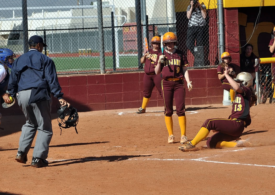 Horace Langford Jr. / Pahrump Valley Times The Trojans base runners ran at will against Desert Pines. Jackie Stobbe steals home after a passed ball. The Trojans defeated Desert Pines in three inni ...