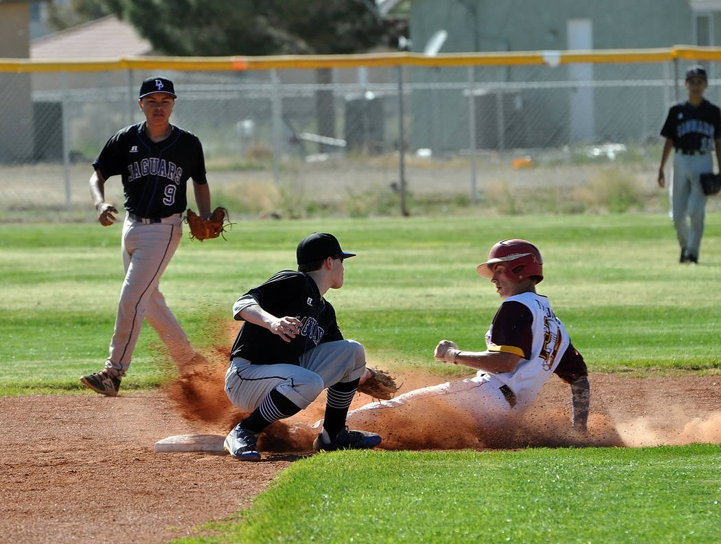 Horace Langford Jr. / Pahrump Valley Times Willie Lucas is seen stealing third base. He got a hit, stole a base and scored a run against the Jaguars on Monday in the Trojans 11-1 defeat of Desert  ...