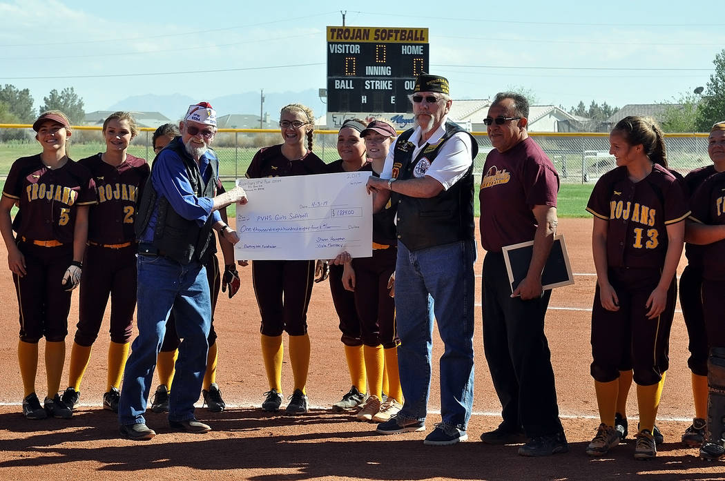 Horace Langford Jr. / Pahrump Valley Times  On Monday before the Trojans softball game with Desert Pines the Pahrump VFW post 10054 presented the Trojans softball team with a check for $1,884, whi ...