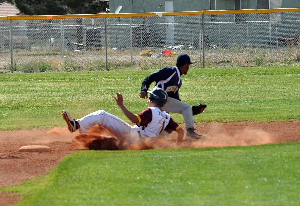 Horace Langford Jr. / Pahrump Valley Times  Garrett Lucas taking stealing second base. Trojans coach Brian Hayes played small ball against Cheyenne, moving his runners into scoring position whenev ...