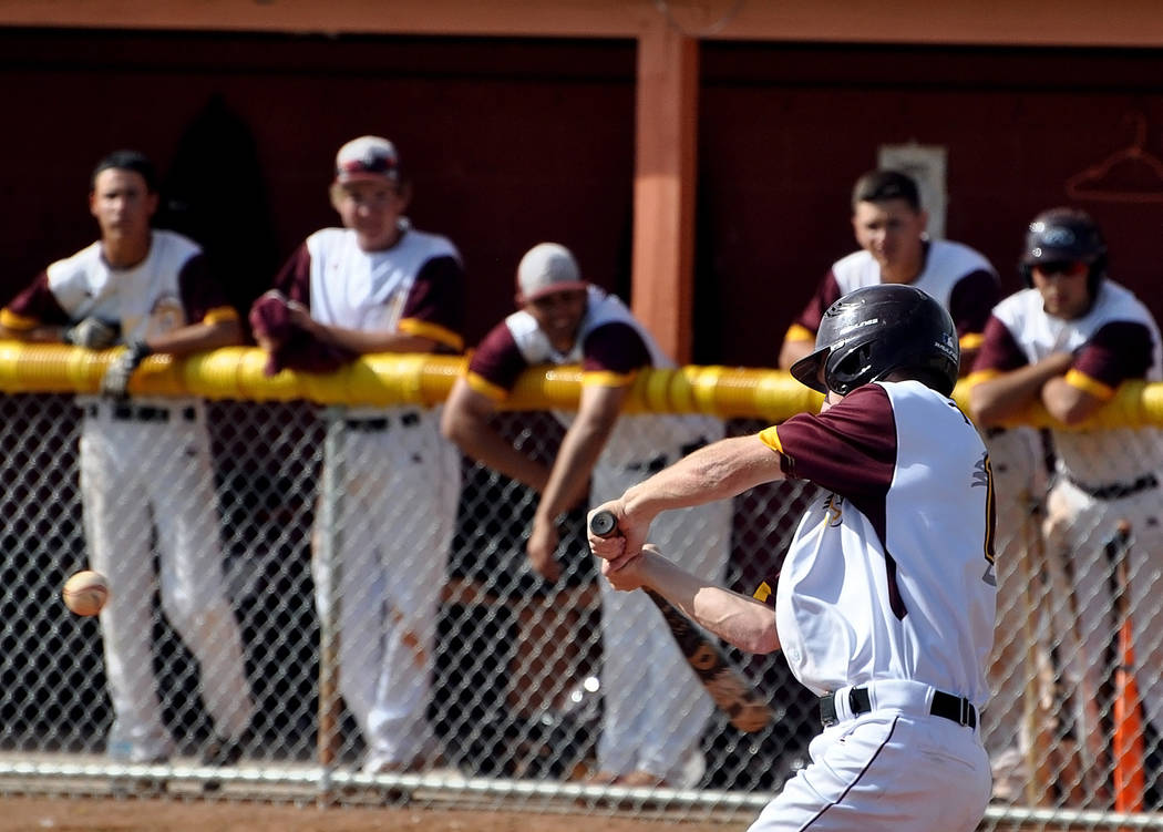 Horace Langford Jr. / Pahrump Valley Times Senior Drew Walker leads off with a hit that causes an error and he gets on base. He scored for the Trojans three times against Cheyenne.