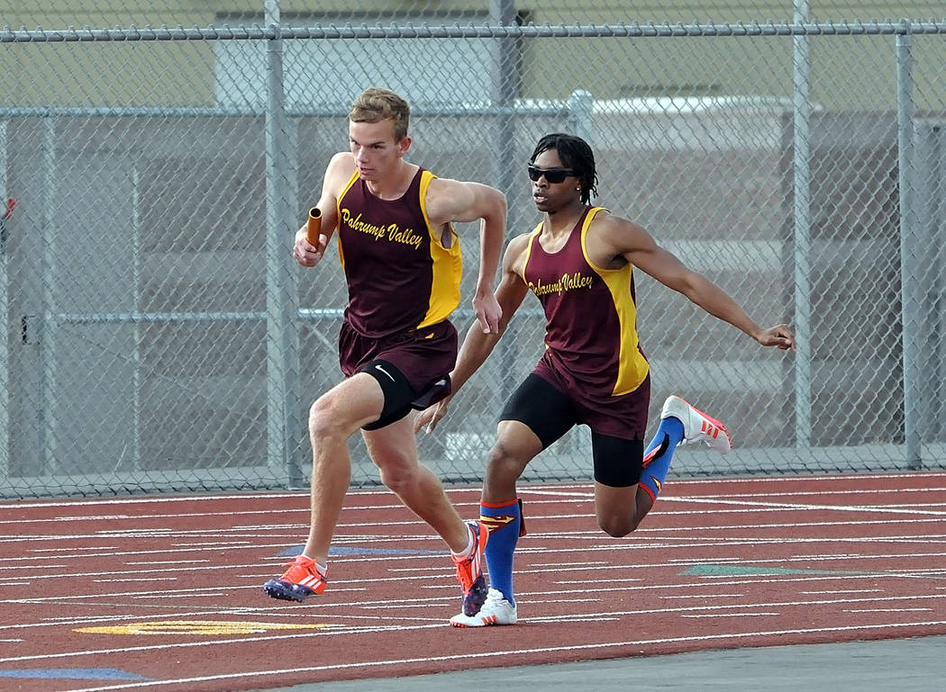 Horace Langford Jr. / Pahrump Valley Times  Senior Dylan Montgomery hands the baton off to his teammate, junior Layron Sonerholm, in the 4x800-meter relay on April 6 at Pahrump Valley High School. ...