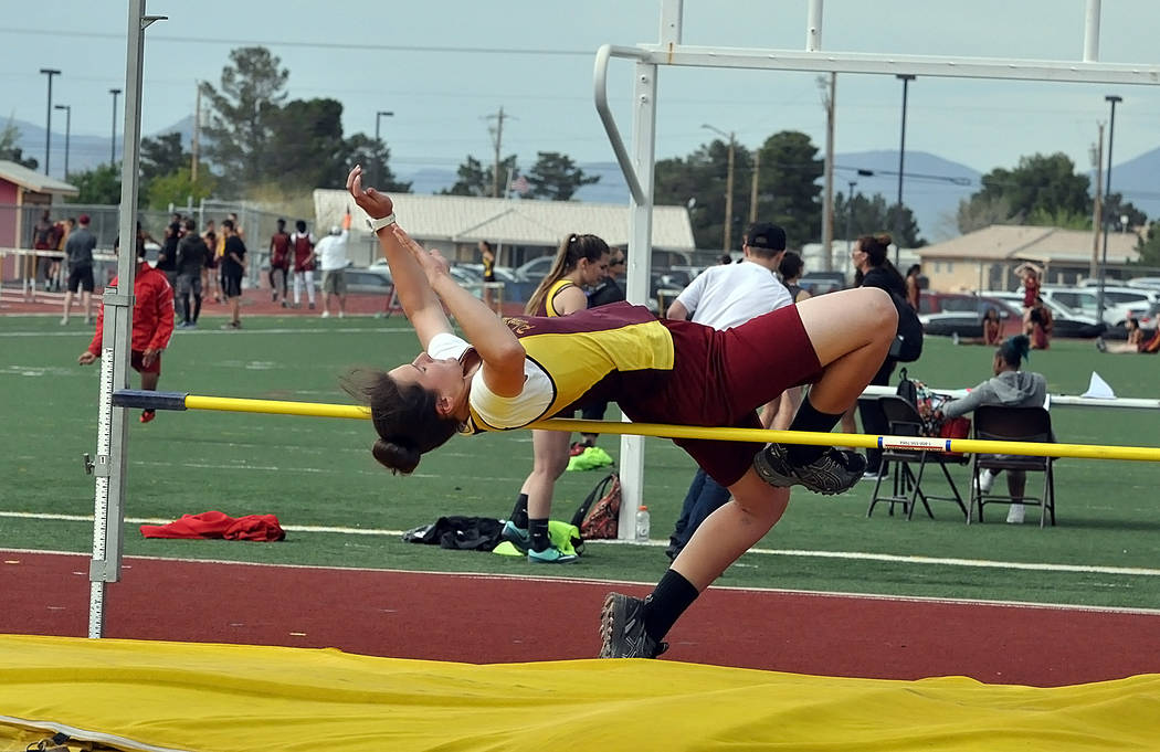 Horace Langford Jr. / Pahrump Valley Times  Abbie Schott goes over the bar at the last home meet of the year for the Lady Trojans. Schott took fifth with a four-foot jump.