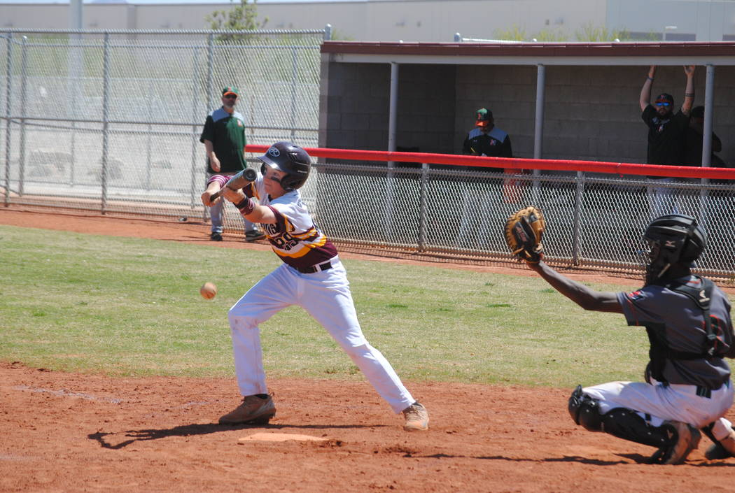 Charlotte Uyeno / Pahrump Valley Times  Chase McDaniel lays down a perfectly executed bunt against Mojave on Wednesday. The Trojans won three of four games during the three-day tourney in Las Vegas.