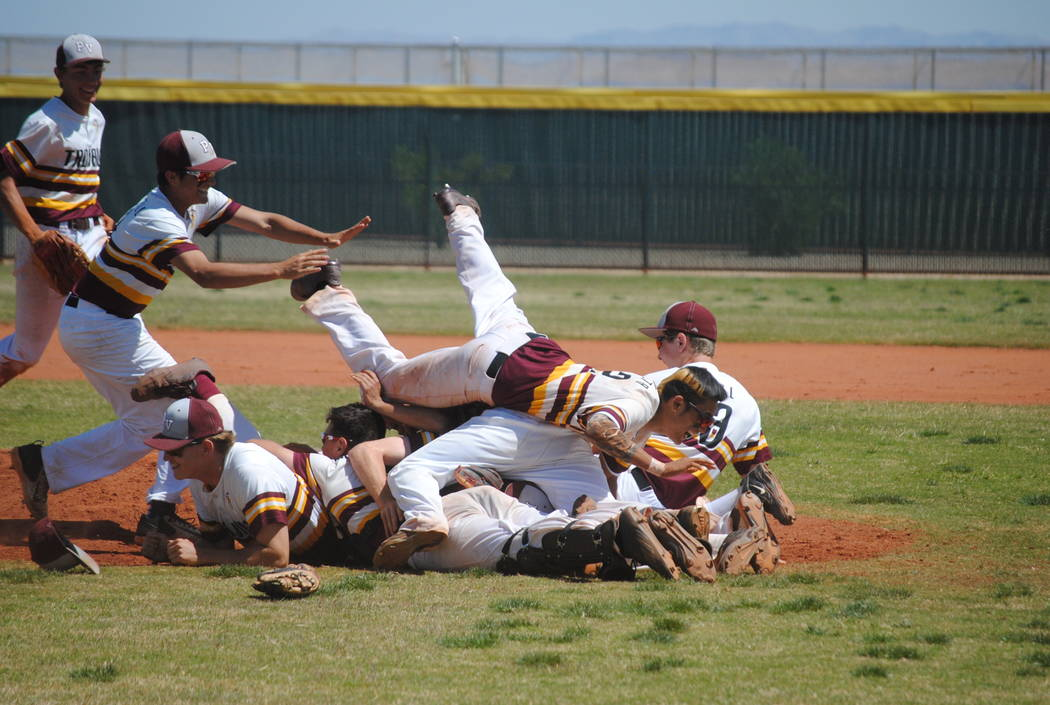 Charlotte Uyeno / Pahrump Valley Times  Trojans pile on after winning the championship title game of the Cowboy Classic, a three-day tourney at Chaparral High School that started on April 10 and e ...