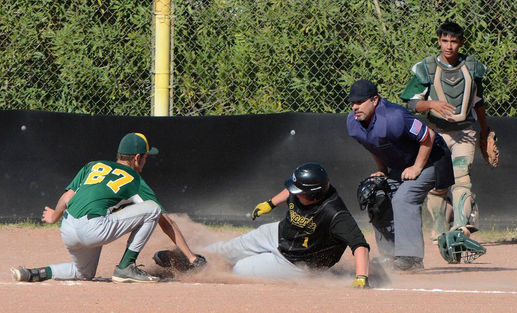 Richard Stephens / Pahrump Valley Times  Jacob Henry tags the runner out at home. Henry had a good game against Spring Mountain. He came into the second game and saved it.