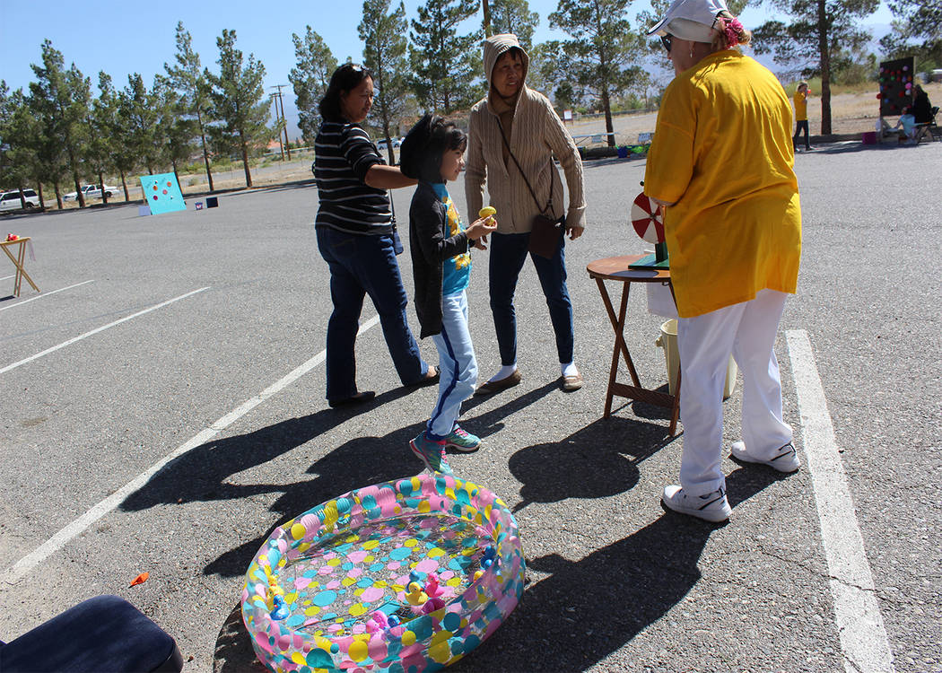 Special to the Pahrump Valley Times  A happy child walks away from the duck pond game with a prize at last year's Spring Festival at Our Lady of the Valley Catholic Church in Pahrump. The kids t ...