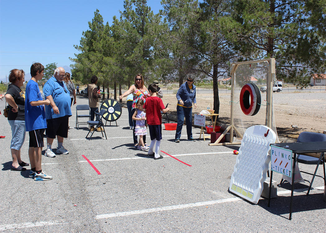 Special to the Pahrump Valley Times  Kids line up to play a football throw game at the Our Lady of the Valley Spring Festival last year, which will be a two-day festival starting on April 22. An a ...