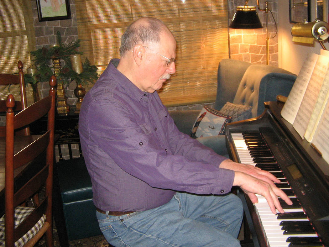 Brenda Klinger/Special to the Pahrump Valley Times Local composer John Salacan plays a few bars from one of his compositions. He has written close to 150 pieces ranging from solos to full symphoni ...
