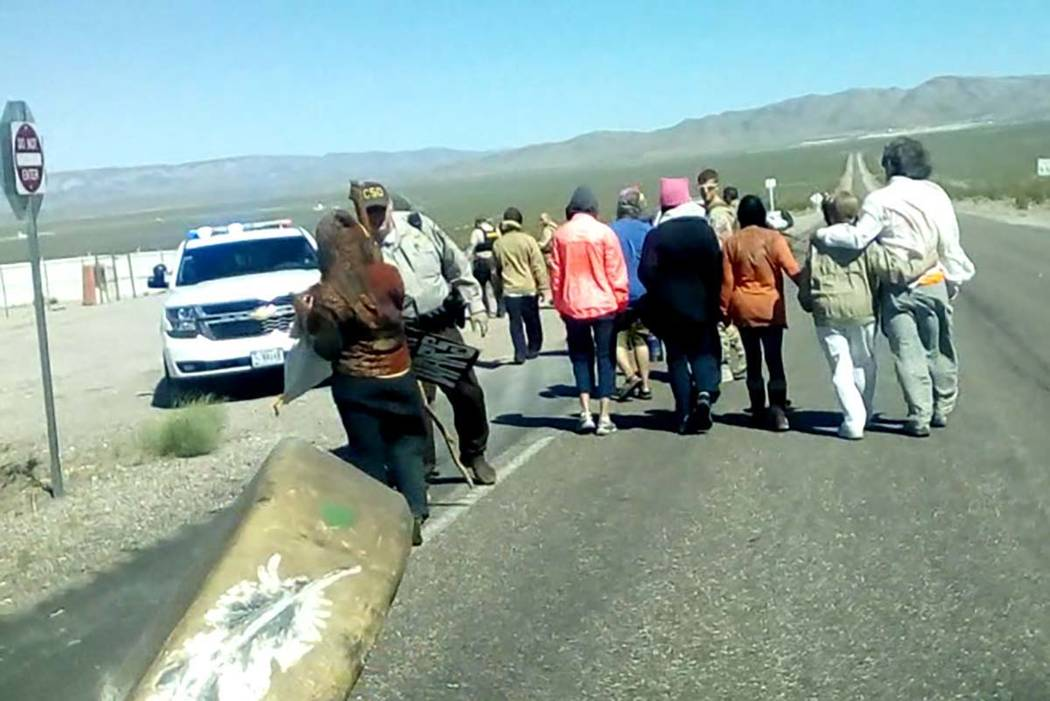 Anti-nuclear demonstrators walk on the Mercury entrance road to the Nevada National Security Site, Thursday, April 13, 2017. (Nevada Desert Experience)