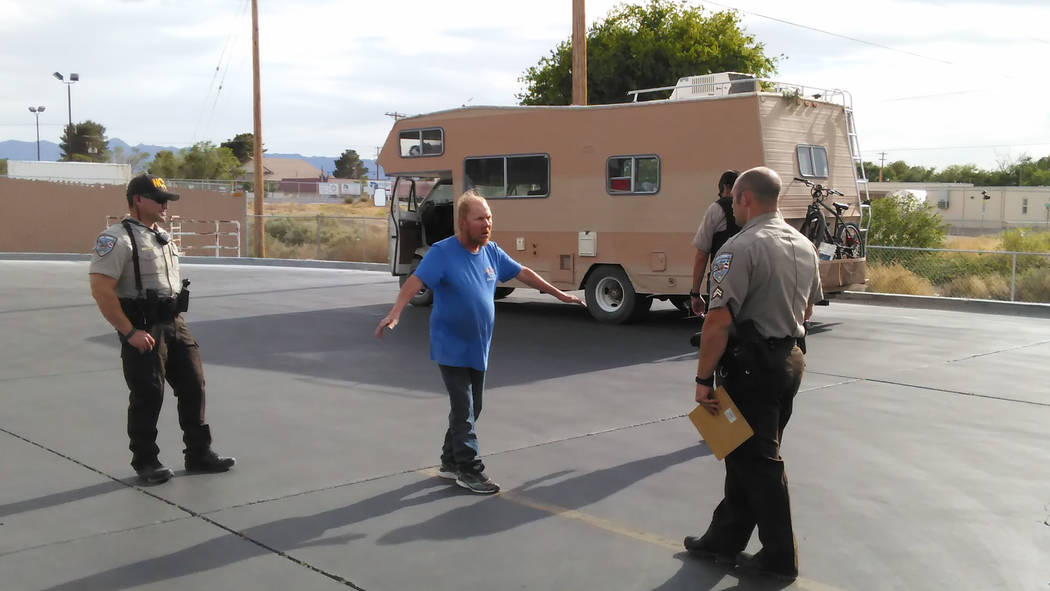 Selwyn Harris / Pahrump Valley Times  Nye County Sheriff's deputies watch as Timothy Perrson undergoes a field sobriety test. Perrson, according to a witness, allegedly ran several stop signs an ...