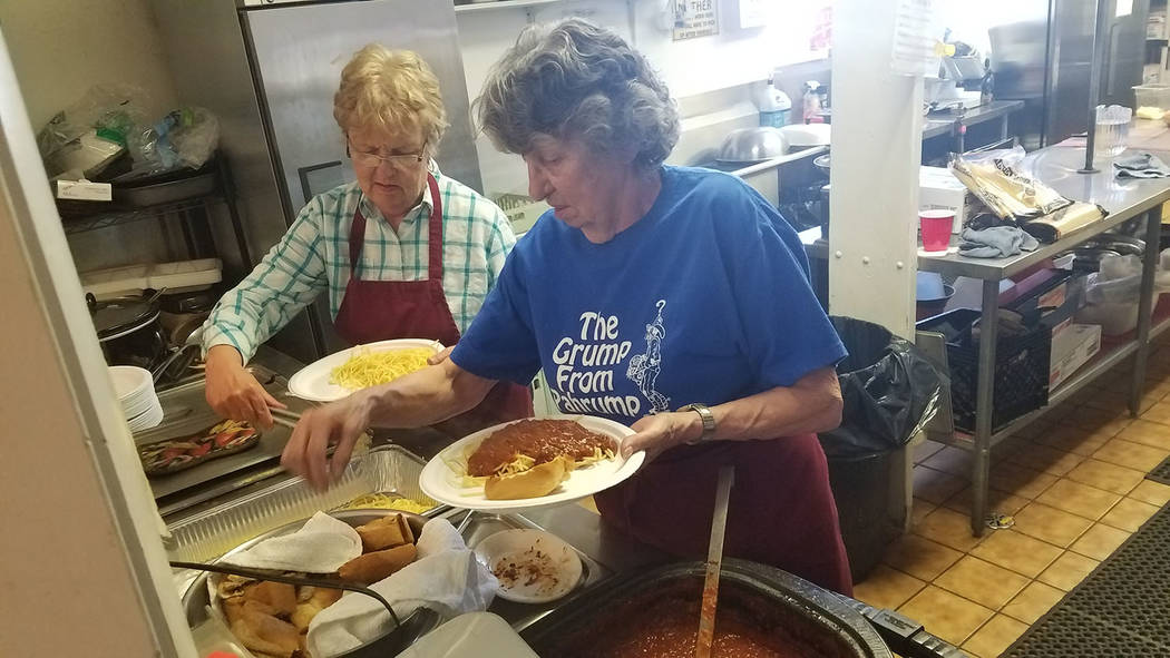 David Jacobs/Tonopah Times-Bonanza A spaghetti dinner is served April 2 inside the Moose Lodge in Pahrump. The event raised money for the Nye County Search and Rescue Team. Besides spaghetti, the  ...