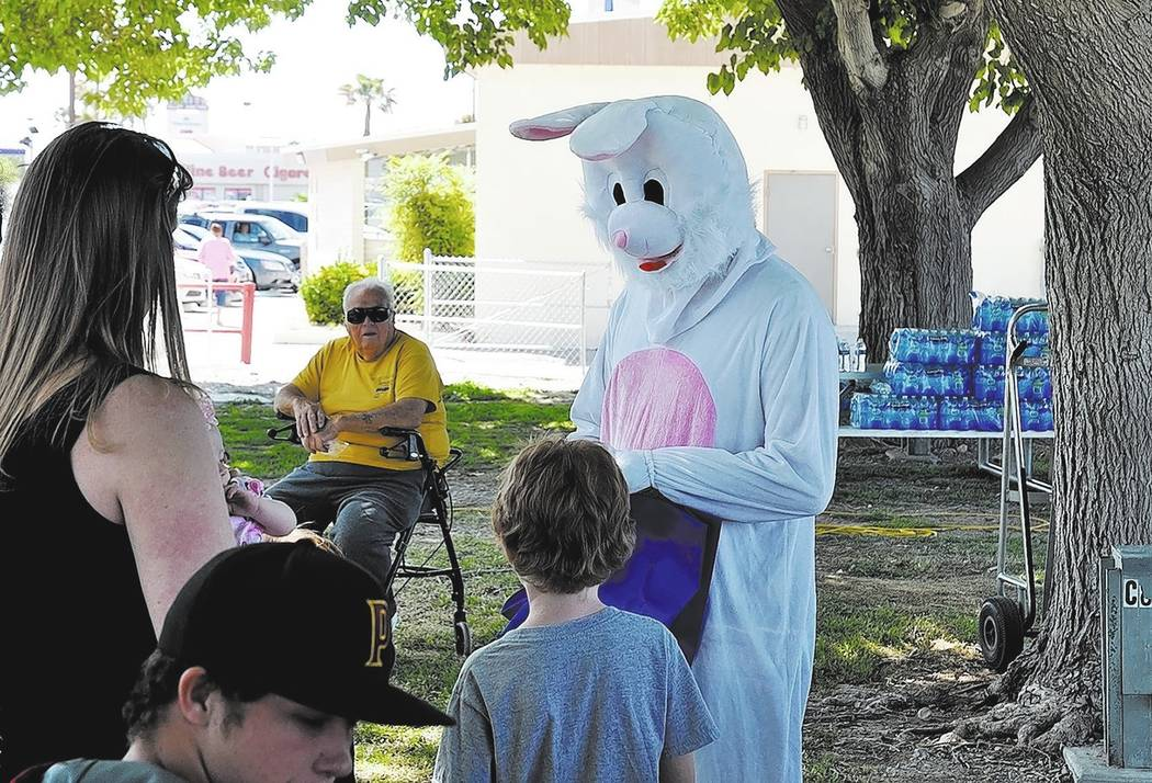 Horace Langford Jr. / Pahrump Valley Times -  Easter picnic Saturday, the Easter Bunny greeting kids