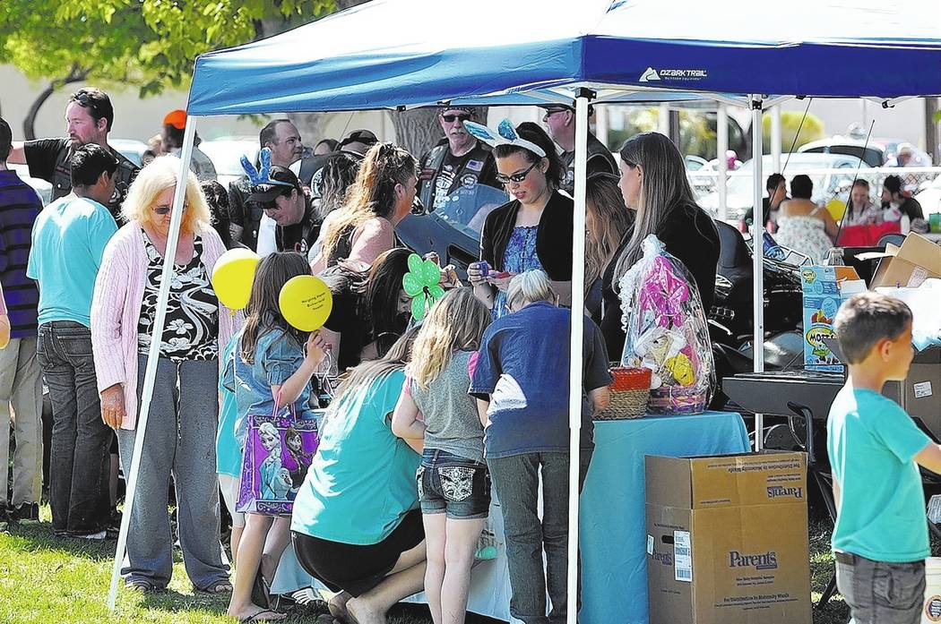 Horace Langford Jr. / Pahrump Valley Times -  Easter picnic Saturday, kids crowd the Healthcare Partners booth