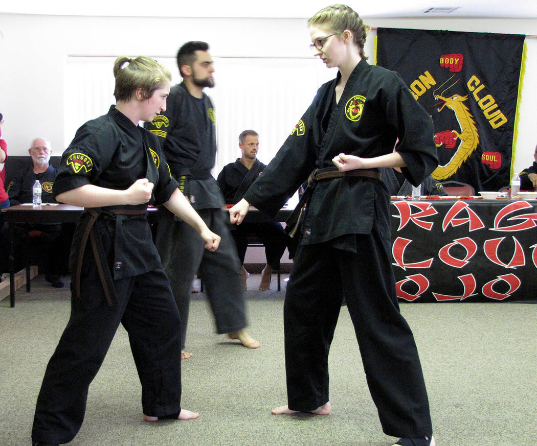 Heather Ruth/Pahrump Valley Times  Reagan Adams and another black belt candidate, Deborah Talley, going over some skills at their black belt test on April 21.