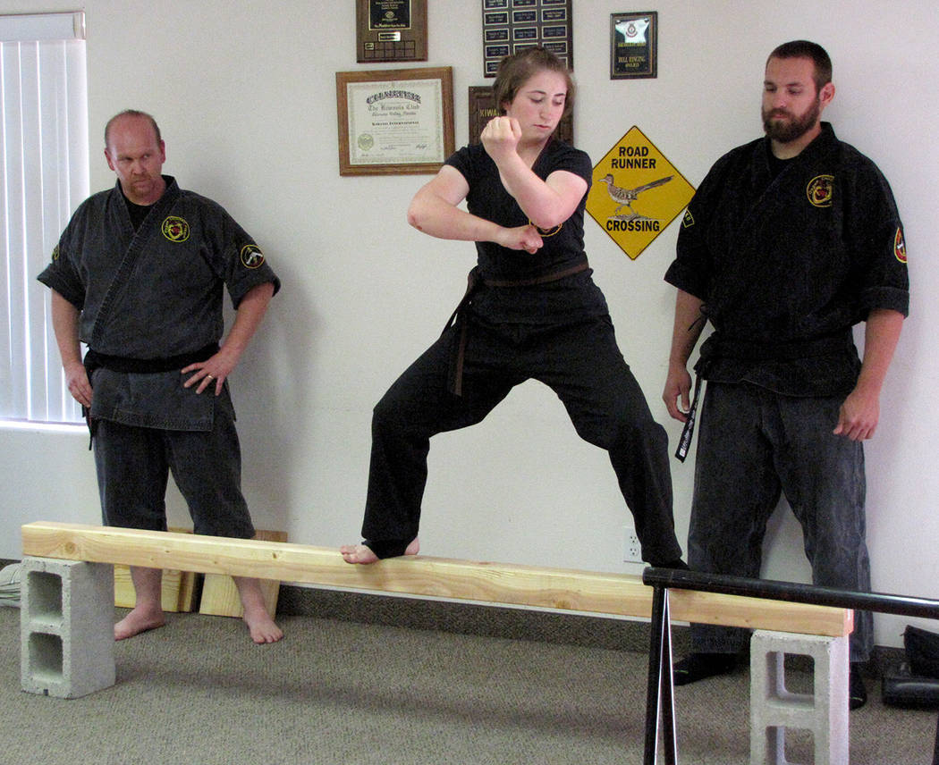 Heather Ruth/Pahrump Valley Times  Reagan Adams demonstrates her skills as she straddles the beam during her seven-hour-long black belt test. This was the last black belt test in Pahrump for Drago ...